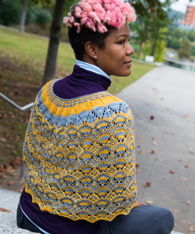 Mosaic knitted shawl in gold and silver in worsted weight yarn.
